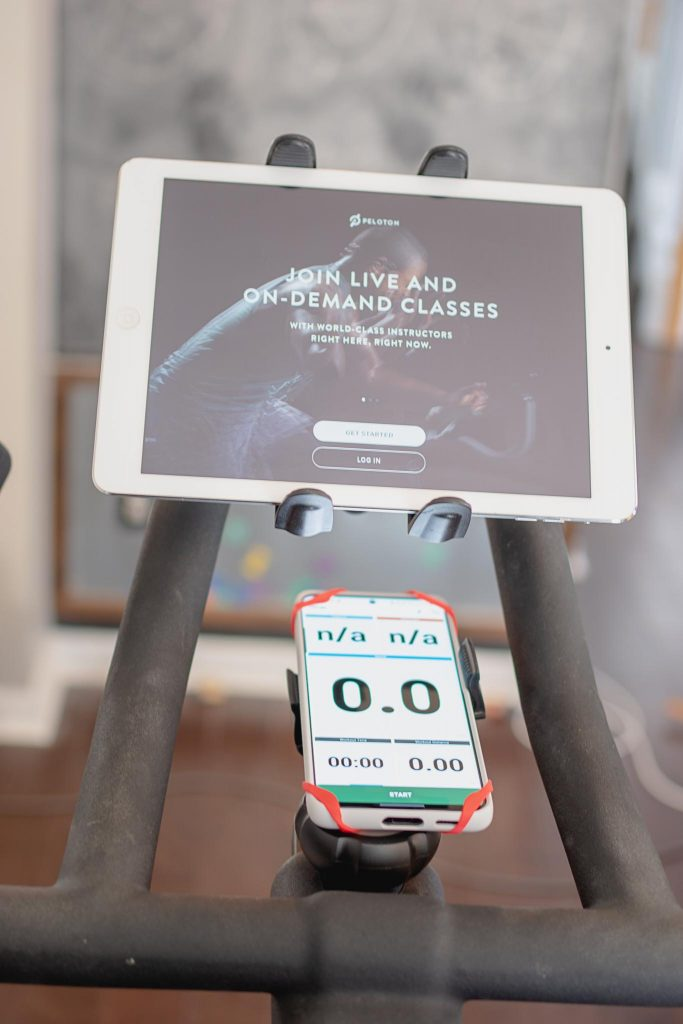 Peloton app screen and Wahoo app screen with tablet and phone mounts